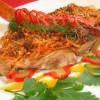 Морской окунь (Люциан) запеченный с карамелизированной морковью и цитрусовым соусом пюре из картофеля, брокколи, грибов и трав.